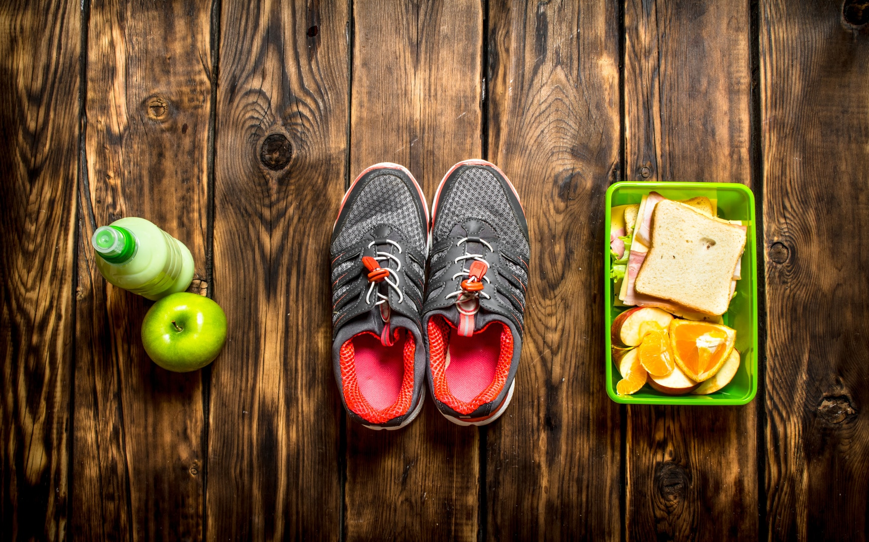 Sandwiches , fruit ,milkshake and sports sneakers