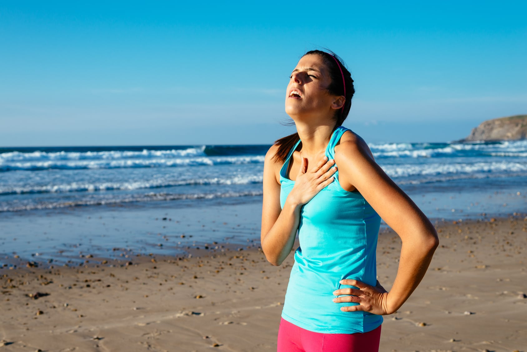 Exhausted female runner suffering painful angina pectoris or asthma breathing problems after training hard on summer. Running overtraining consequence.