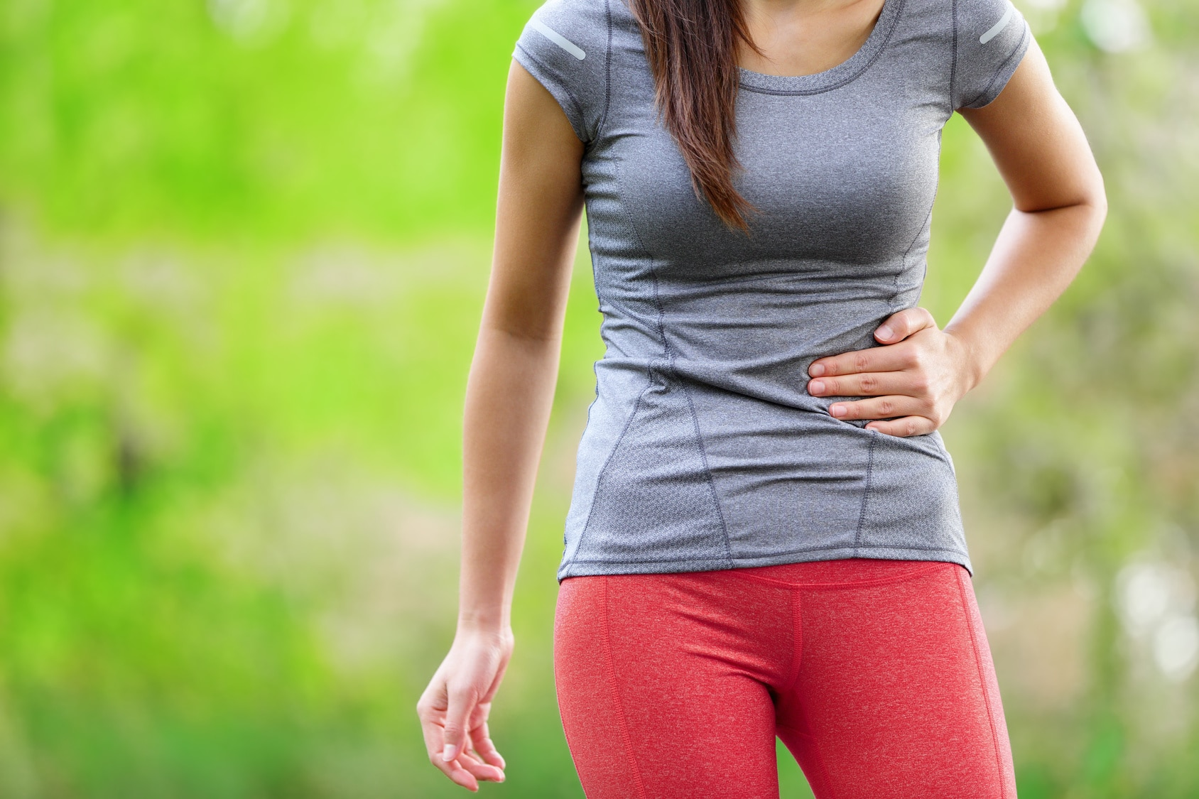 Side stitch - woman runner side cramps