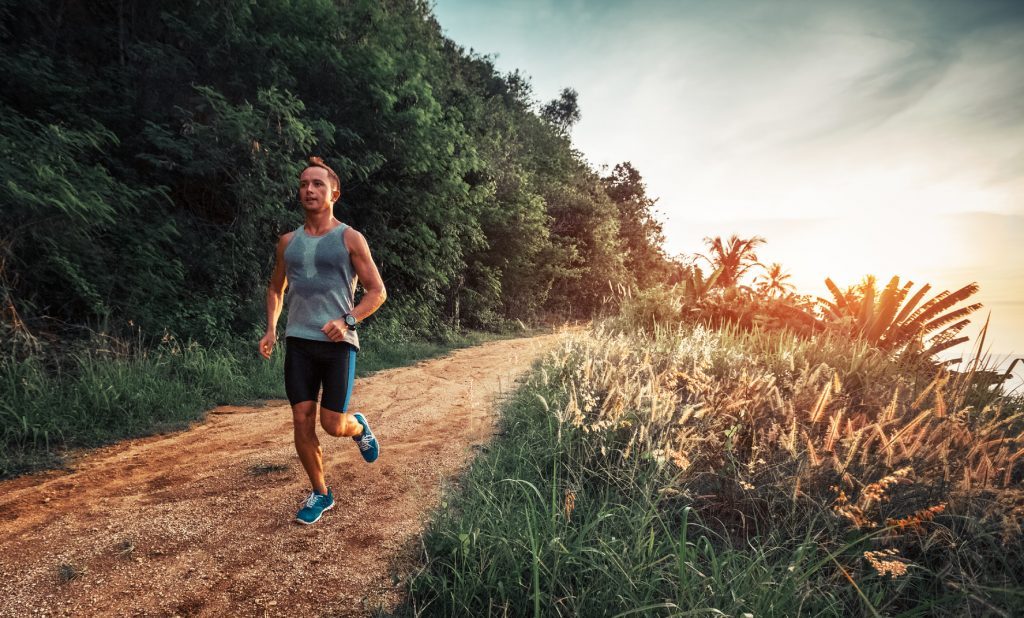 runner sweating while running on a trail