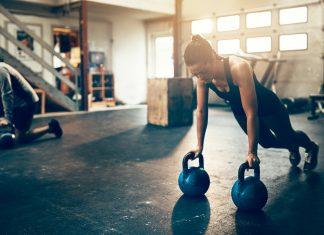 female athlete peforming planks